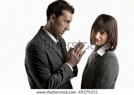 Businessman begging to a businesswoman