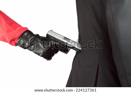 Businessman being attacked by a criminal - stock photo