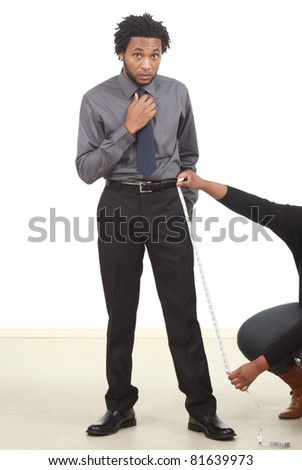 Businessman being measured - stock photo