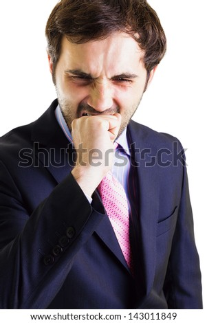 Businessman biting his fist, white background. Conceptual image. - stock photo
