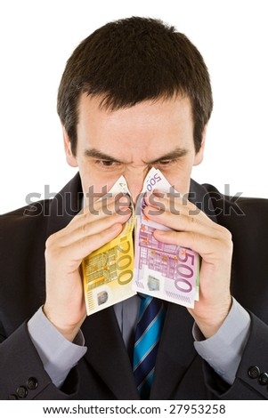 Businessman blowing his nose into the banknotes - isolated