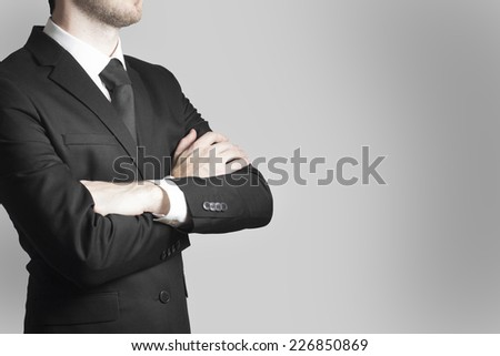 businessman boss in black suit crossed arms work warning - stock photo