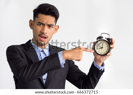 Businessman/boss/manager showing alarm clock on white background, working time, late, punctual concept.