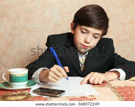 businessman  boy in black suit coffee write  sit at the table close up portrait - stock photo
