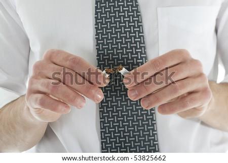 Businessman braking cigarettes. Concept: give up smoking - stock photo