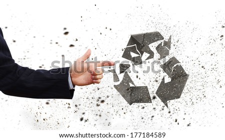 Businessman breaking recycle stone symbol with finger