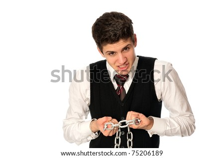 businessman breaking the chain by hands for liberation as a symbol of work captivity - stock photo