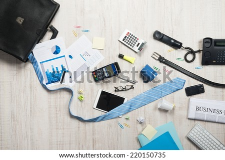 Businessman briefcase with paperwork and accessories on the floor, business failure concept. - stock photo