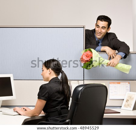 Businessman bringing co-worker flowers - stock photo