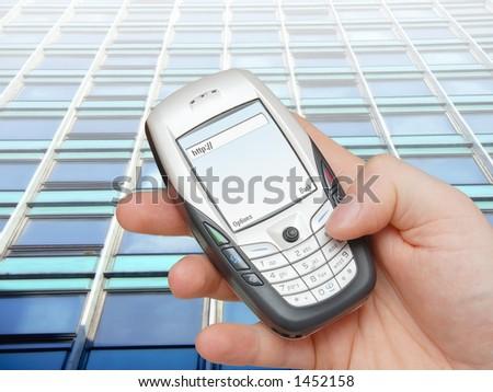 Businessman browsing internet using advanced mobile phone - stock photo