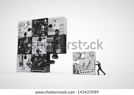 businessman building puzzle with business strategy - stock photo