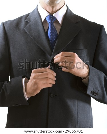 businessman buttons up the button on the suit