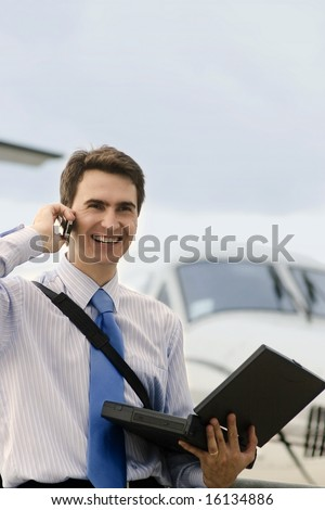 Businessman buy tickets on plane through internet - stock photo