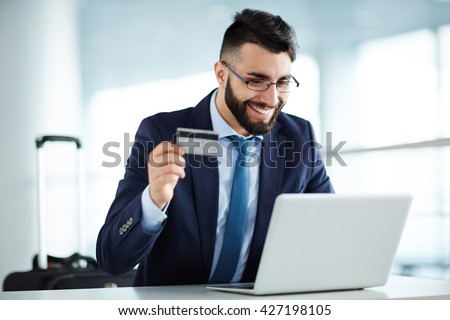Businessman buying airline tickets online