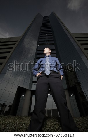 Businessman by a tall building