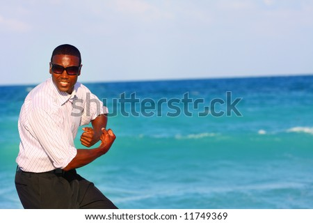 Businessman by the ocean - stock photo