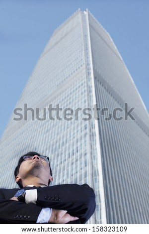 Businessman by the world trade center in Beijing - stock photo