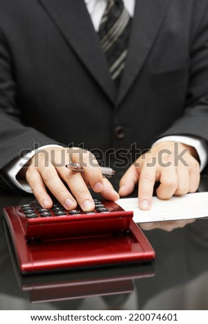 businessman calculating expenses - stock photo