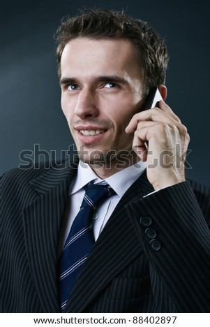 businessman calling by smartphone - stock photo