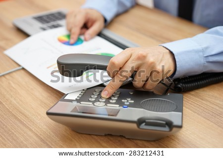 businessman calling client to inform him of the company's operations - stock photo