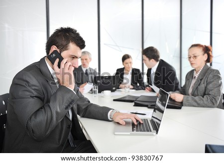 Businessman calling on phone, business meeting at background - stock photo