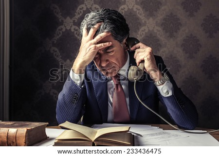Businessman calling someone  - stock photo