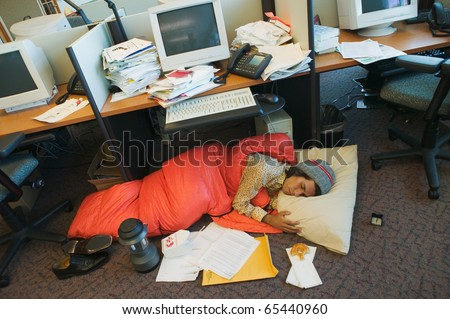 Businessman camping in office - stock photo