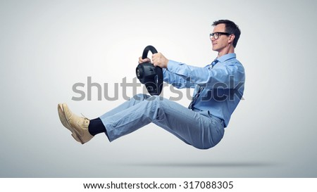 Businessman car driver in glasses and tie with a wheel - stock photo