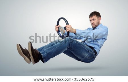 Businessman car driver with a steering wheel