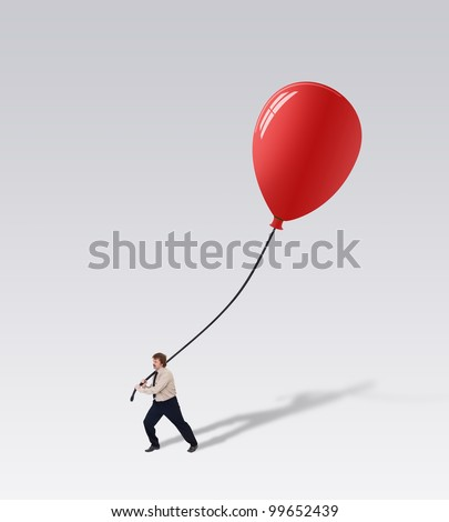 Businessman carry a big balloon - promoting a great new business idea concept - stock photo
