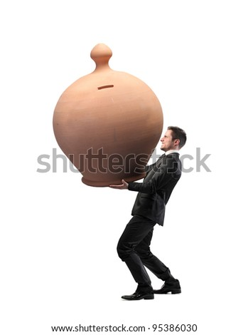 Businessman carrying a giant money box - stock photo