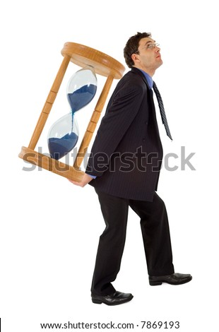 Businessman carrying a hourglass - concept for working under the pressure of a deadline - isolated - stock photo