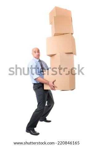 Businessman carrying a stack of cardboard boxes - stock photo