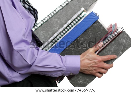 Businessman carrying a stack of files, concept for overwork, busy or multi-tasking - stock photo