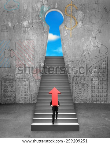Businessman carrying big 3D red arrow sign and climbing on stairs to key shape door with sky view - stock photo