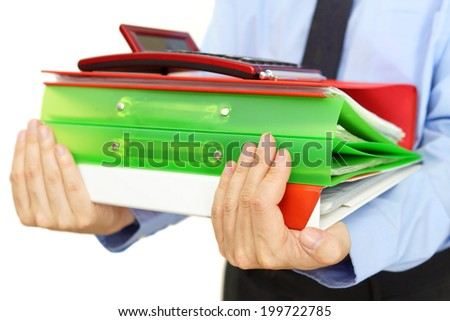businessman carrying binders with documents and calculator - stock photo