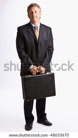 Businessman carrying briefcase - stock photo