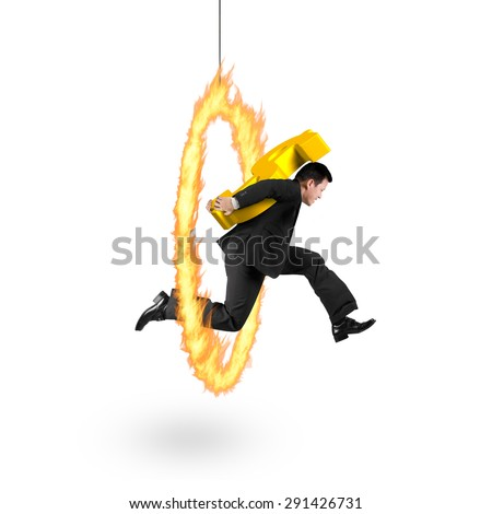 Businessman carrying 3D golden dollar sign, jumping through fire hoop, with isolated on white background. - stock photo