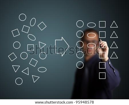 businessman categorizing geometry drawing - stock photo