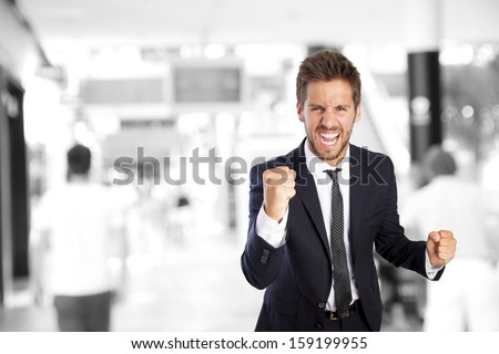 businessman celebrating his success in a company - stock photo