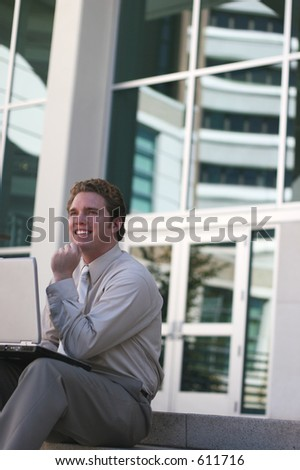 businessman celebrating on step with laptop