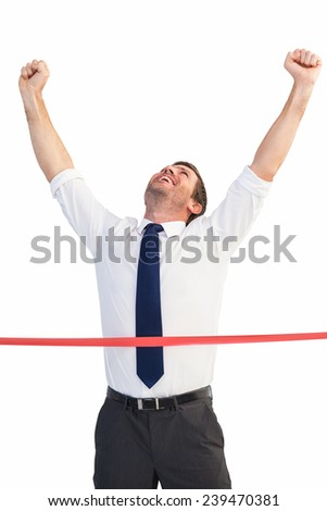Businessman celebrating success with arms up on white background