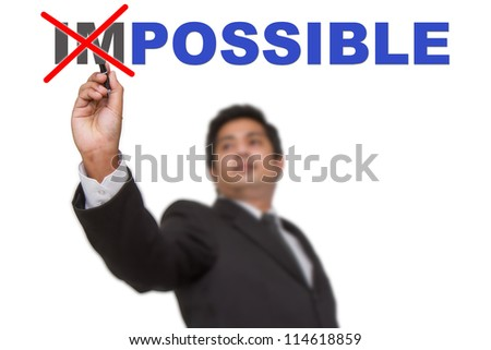 Businessman changing word impossible into possible - stock photo