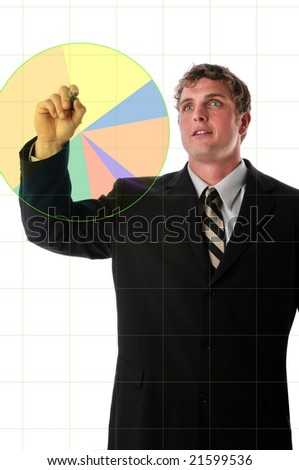 Businessman charting a color graphic over electronic board