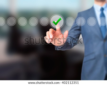 Businessman check mark on virtual screen. Finger on a checklist box and ticking. Business technology concept. Isolated on grey. Stock Image - stock photo