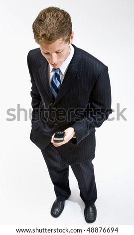 Businessman checking cell phone - stock photo