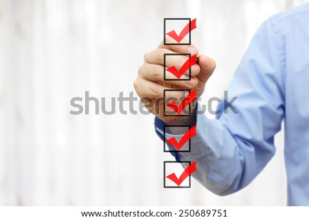 businessman checking final  mark on checklist - stock photo