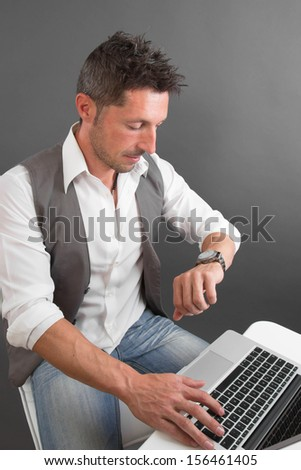 Businessman checking his watch - stock photo