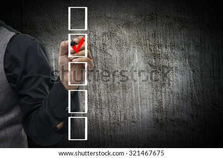 Businessman checking mark on checklist  - stock photo