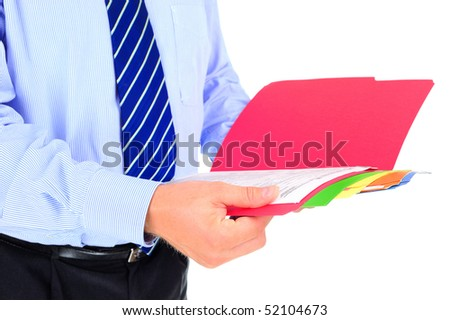 Businessman checking papers - stock photo
